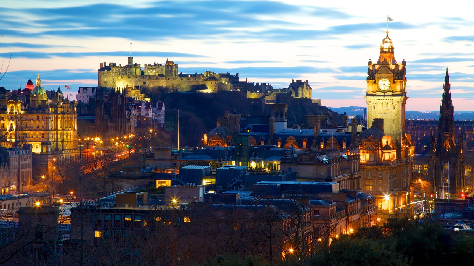 Calton Hill which includes night scenes, heritage architecture and a city