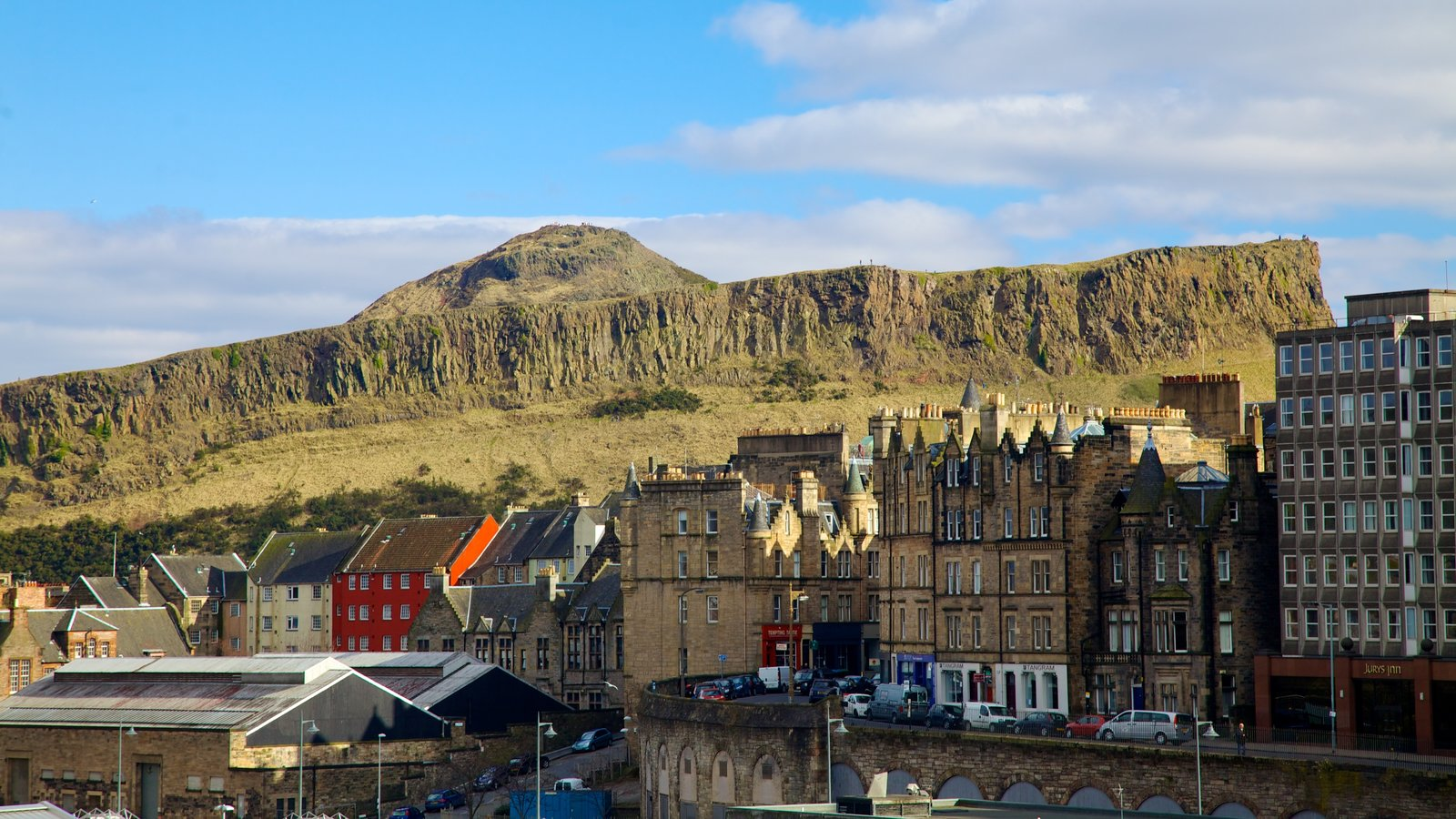 Arthur\'s Seat which includes mountains and a small town or village