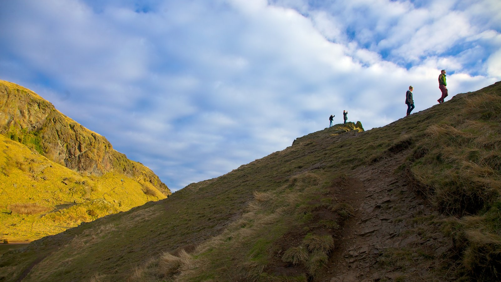 Arthur\\\'s Seat which includes hiking or walking, mountains and tranquil scenes