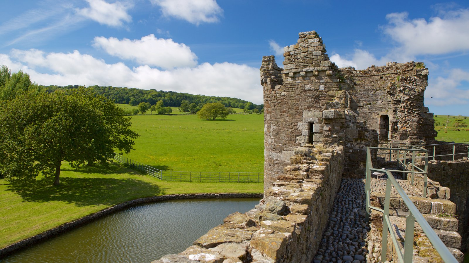 Beaumaris Castle showing tranquil scenes, a castle and a ruin