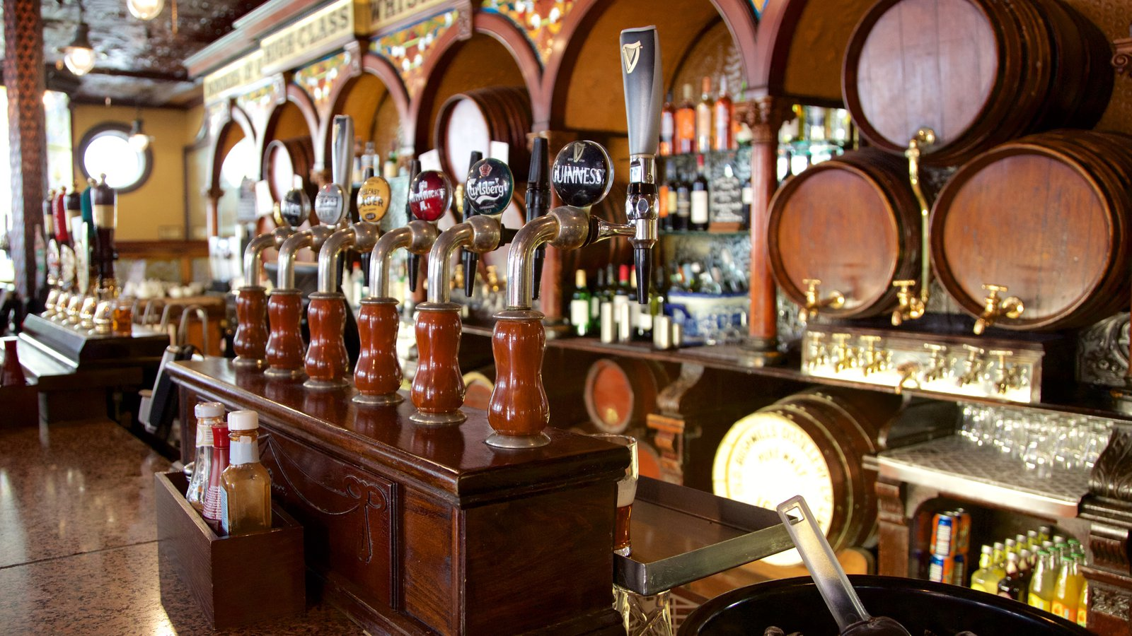 Belfast showing interior views, a bar and drinks or beverages