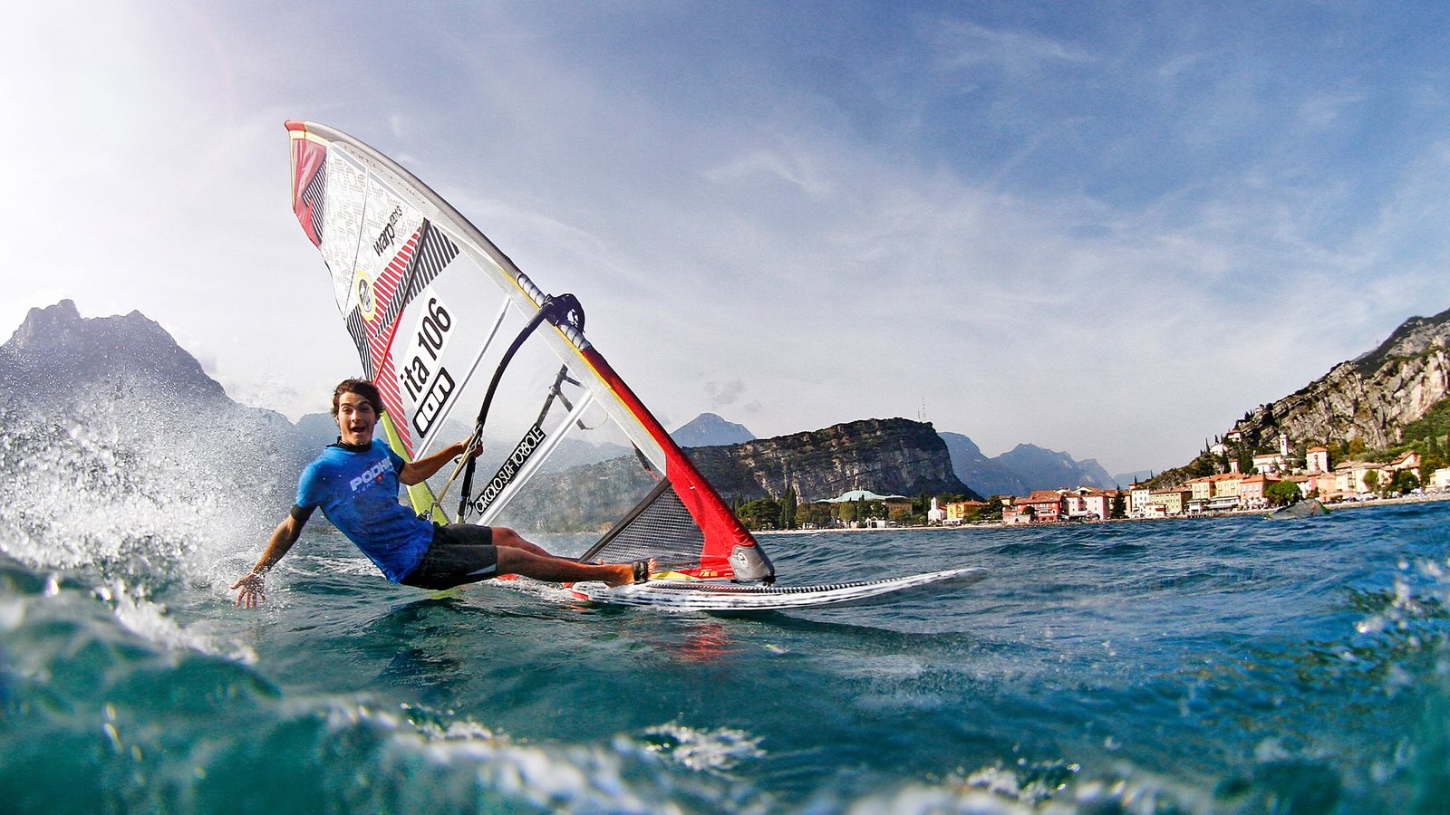 Trentino featuring windsurfing, a lake or waterhole and a coastal town