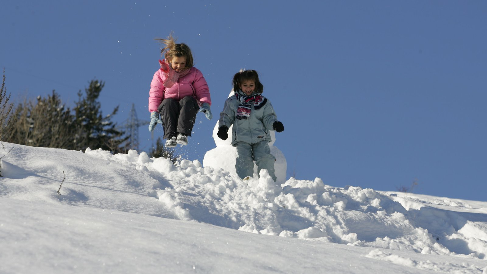 Livigno Ski Area featuring snow as well as children