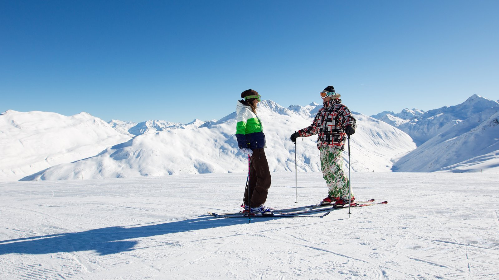 Livigno Ski Area which includes mountains, tranquil scenes and snow