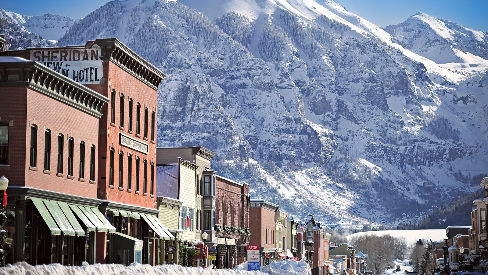 Telluride Ski Resort Which Includes A Small Town Or Village Mountains And Snow
