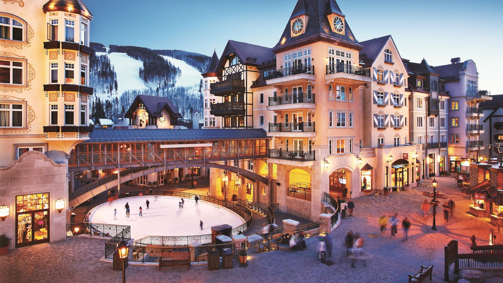 Vail showing a square or plaza a luxury hotel or resort and ice skating