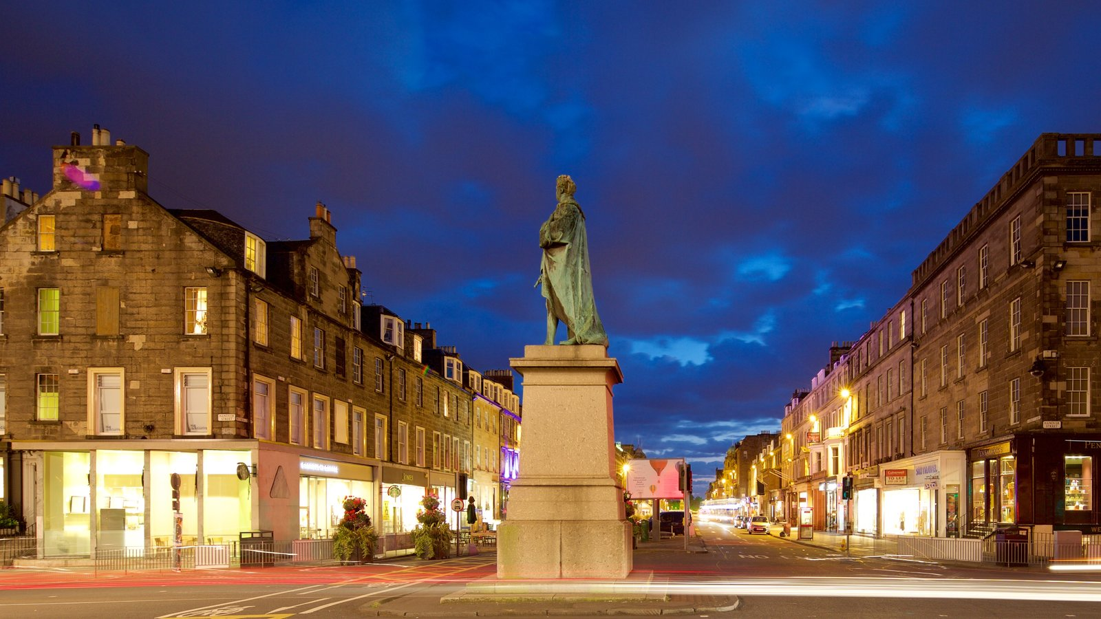 Edinburgh showing street scenes, night scenes and a monument