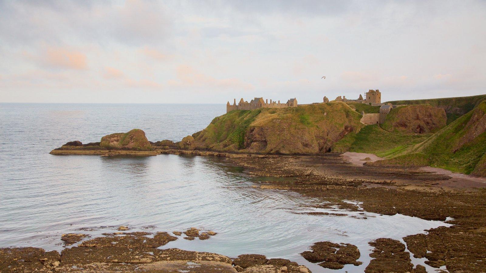Dunnottar Castle featuring rocky coastline
