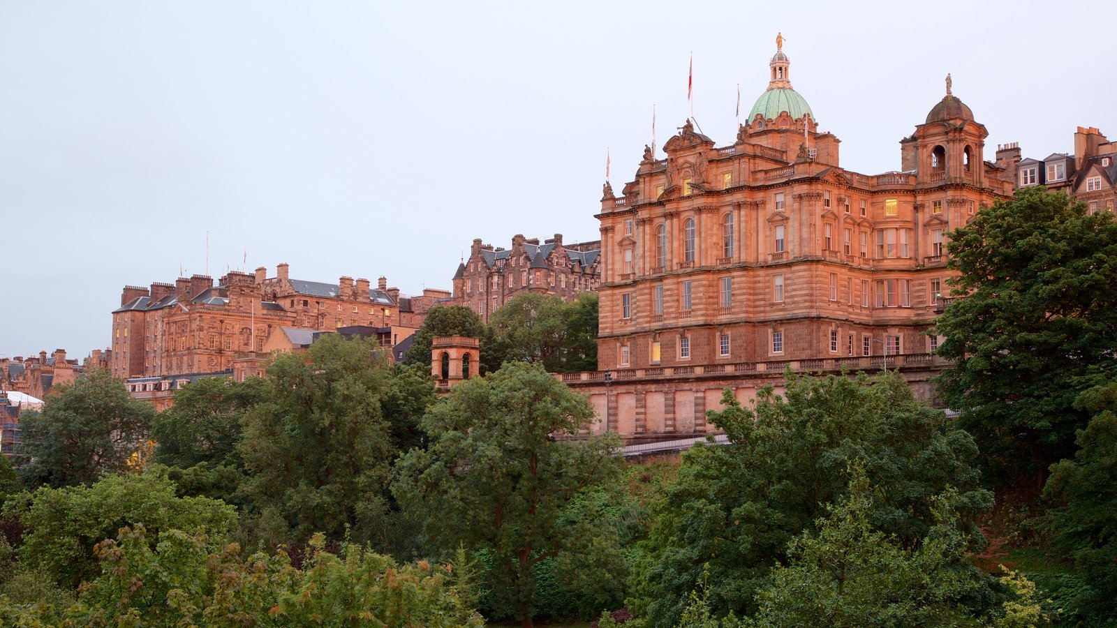 Princes Street Gardens showing a sunset and heritage elements