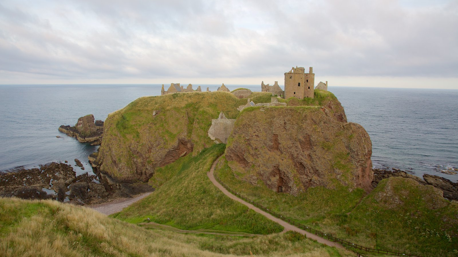 Dunnottar Castle showing a castle, general coastal views and farmland