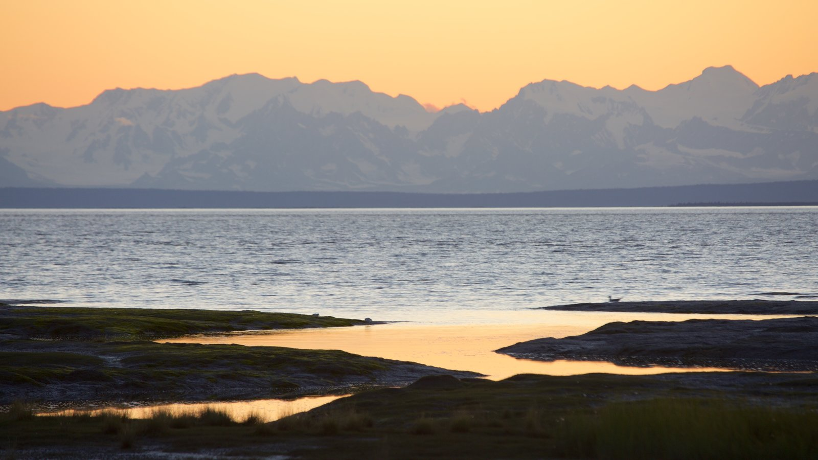 Anchorage which includes general coastal views and a sunset