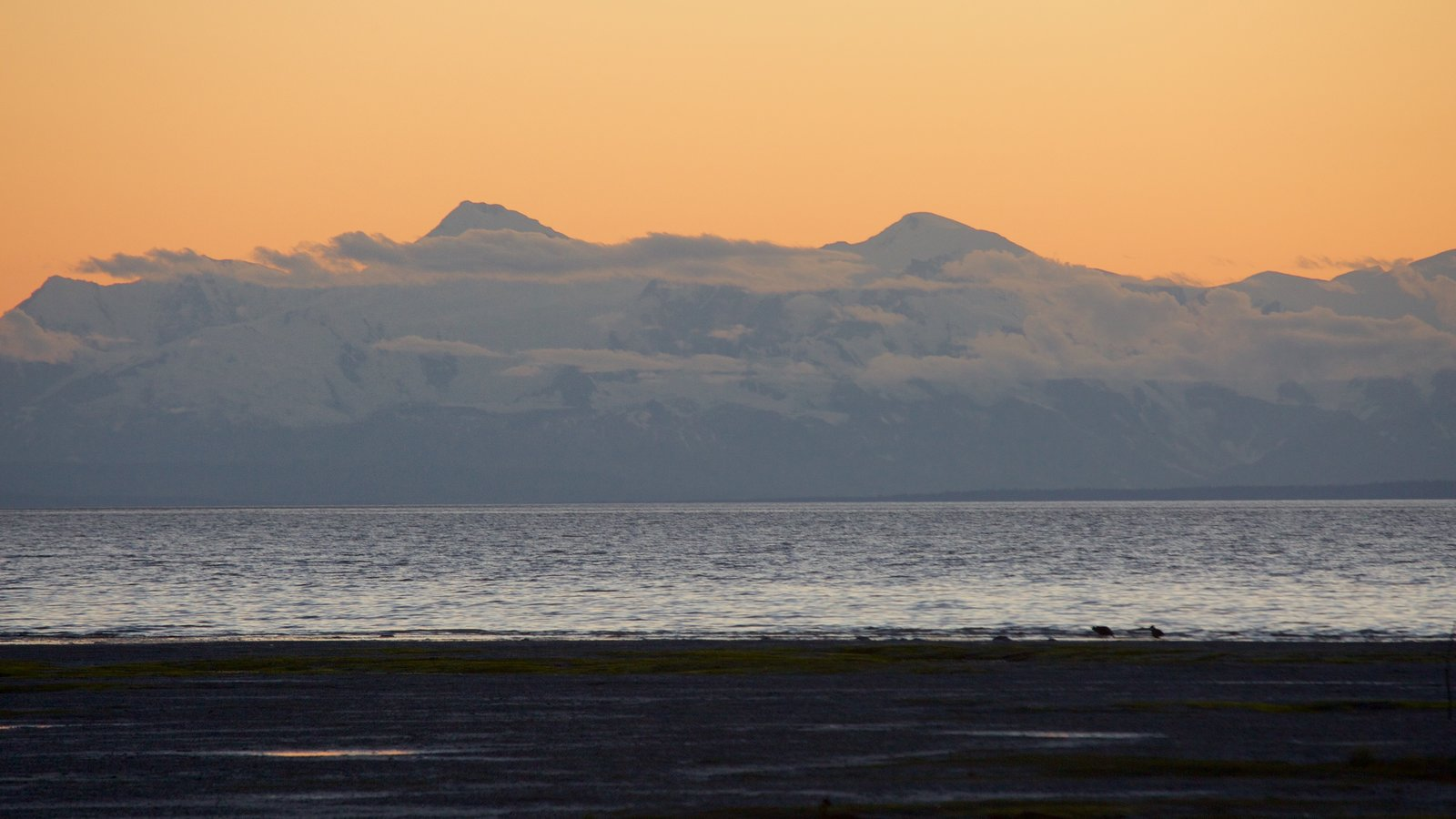 Anchorage showing a sunset, general coastal views and mountains