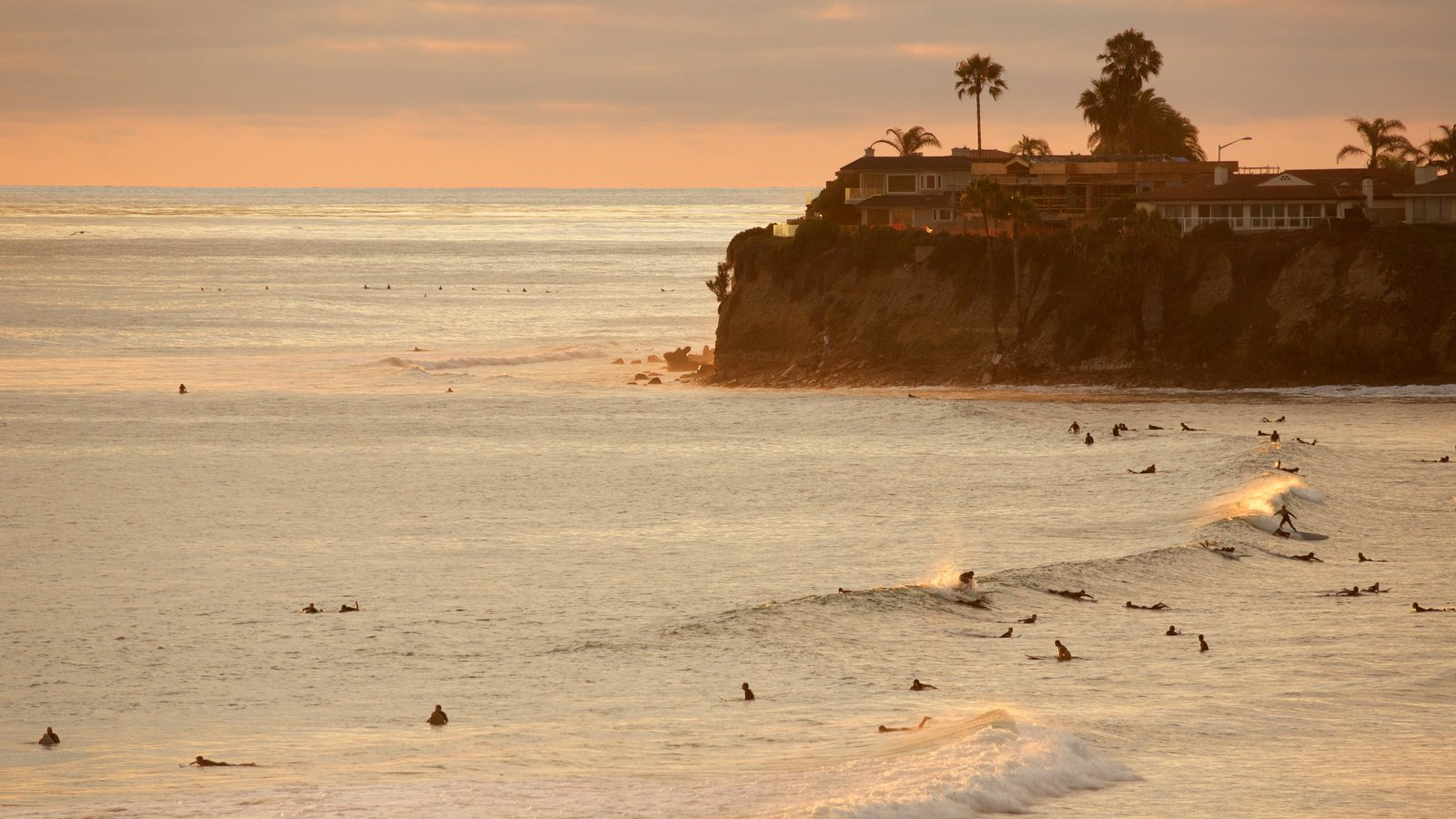 Pacific Beach Park which includes surfing, general coastal views and rocky coastline
