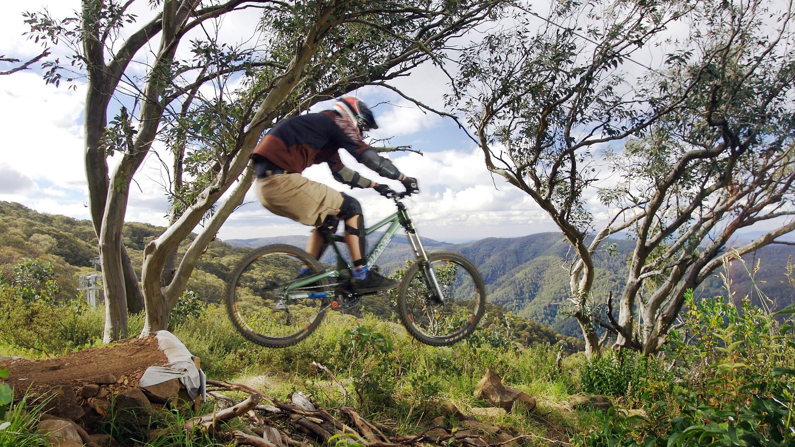 Mt. Buller Ski Slopes featuring mountain biking and mountains as well as an individual male