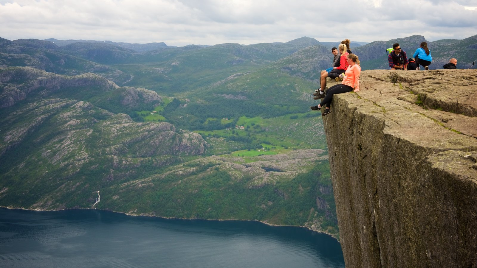 Preikestolen which includes views and a lake or waterhole as well as a small group of people