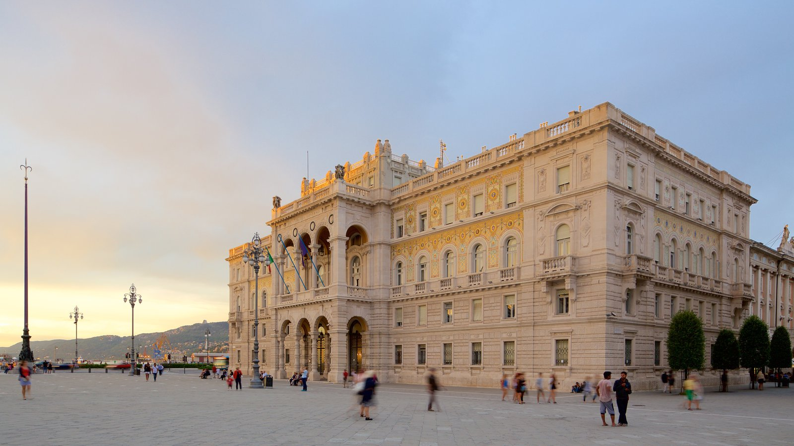 Piazza dell\'Unita featuring a sunset, heritage architecture and a square or plaza
