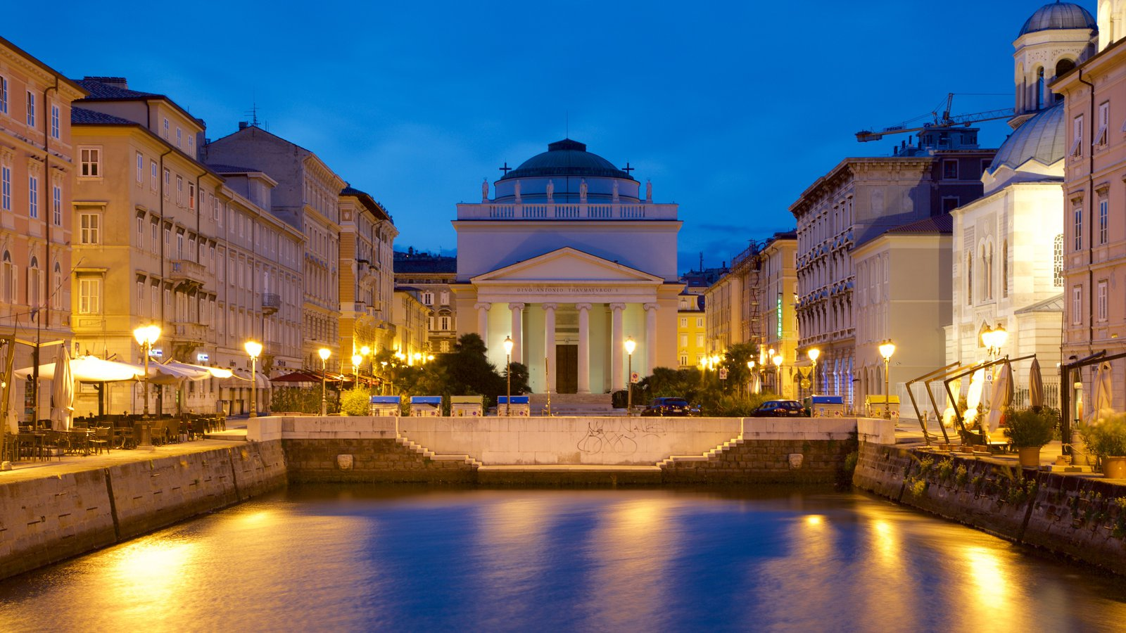 Trieste showing a pond, night scenes and heritage architecture