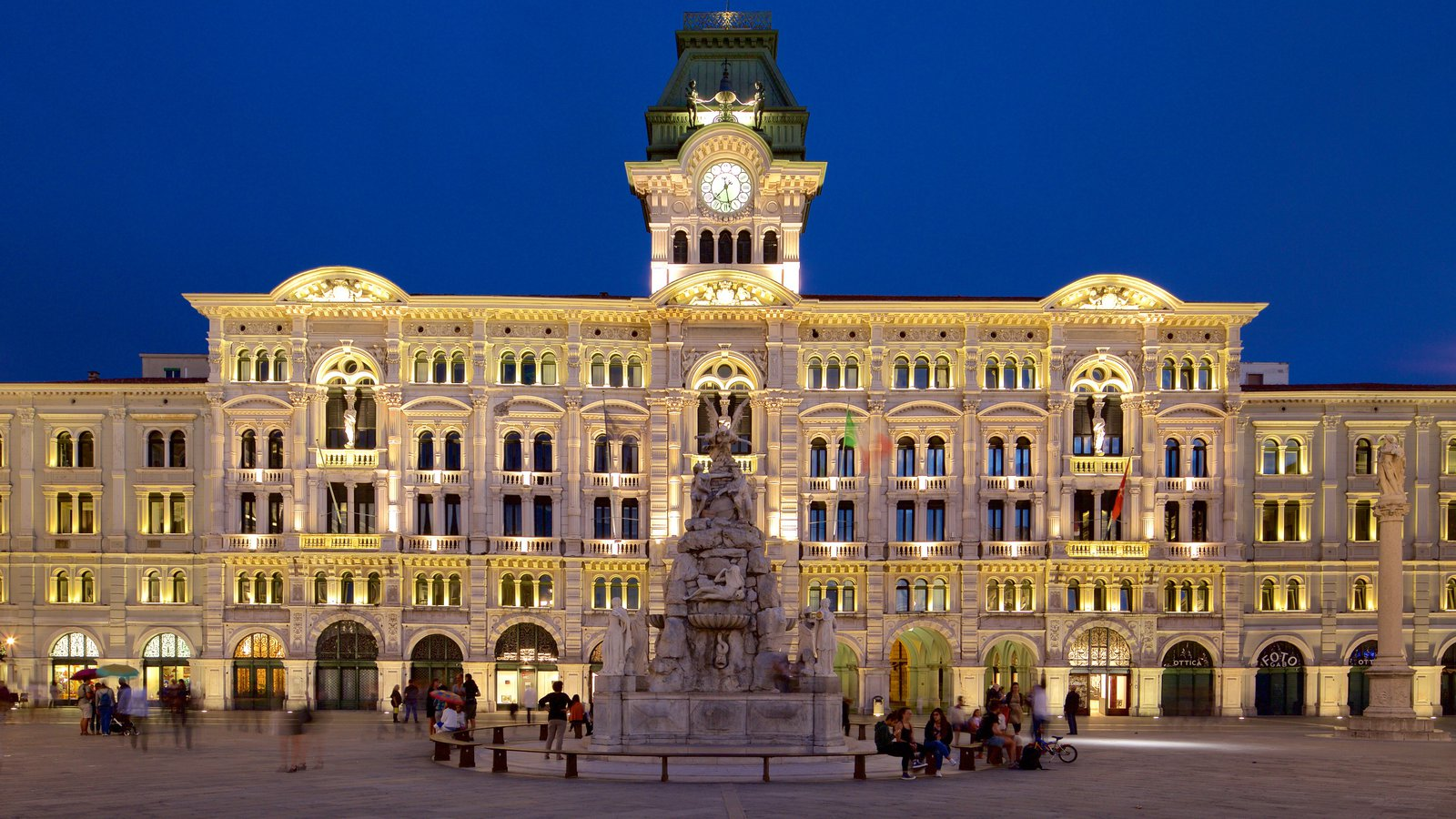 Palazzo del Municipio showing a square or plaza, night scenes and heritage architecture