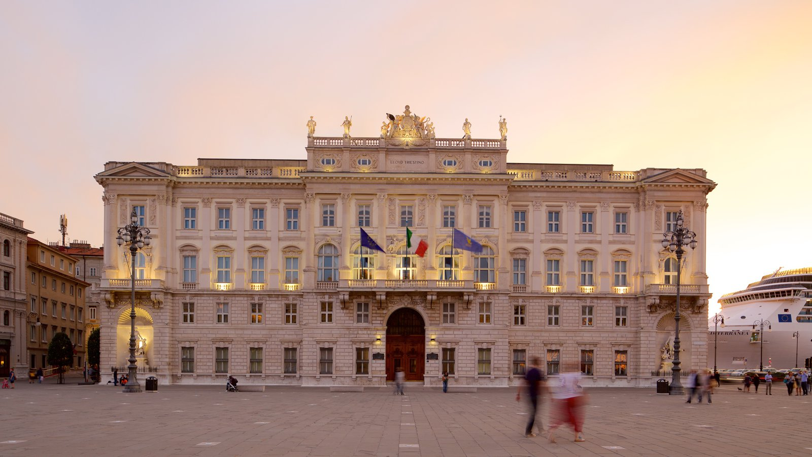 Piazza dell\'Unita featuring a sunset, a square or plaza and an administrative buidling