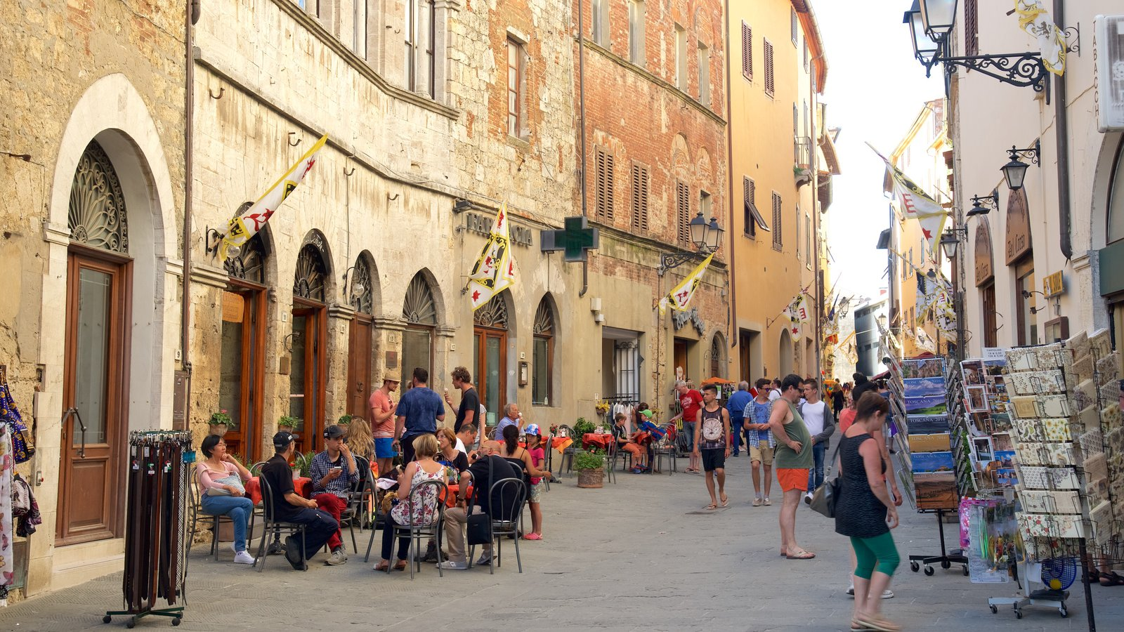Massa Marittima showing heritage architecture as well as a large group of people