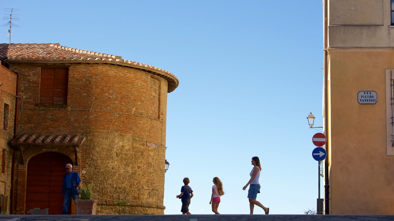 Panicale showing heritage architecture as well as a family