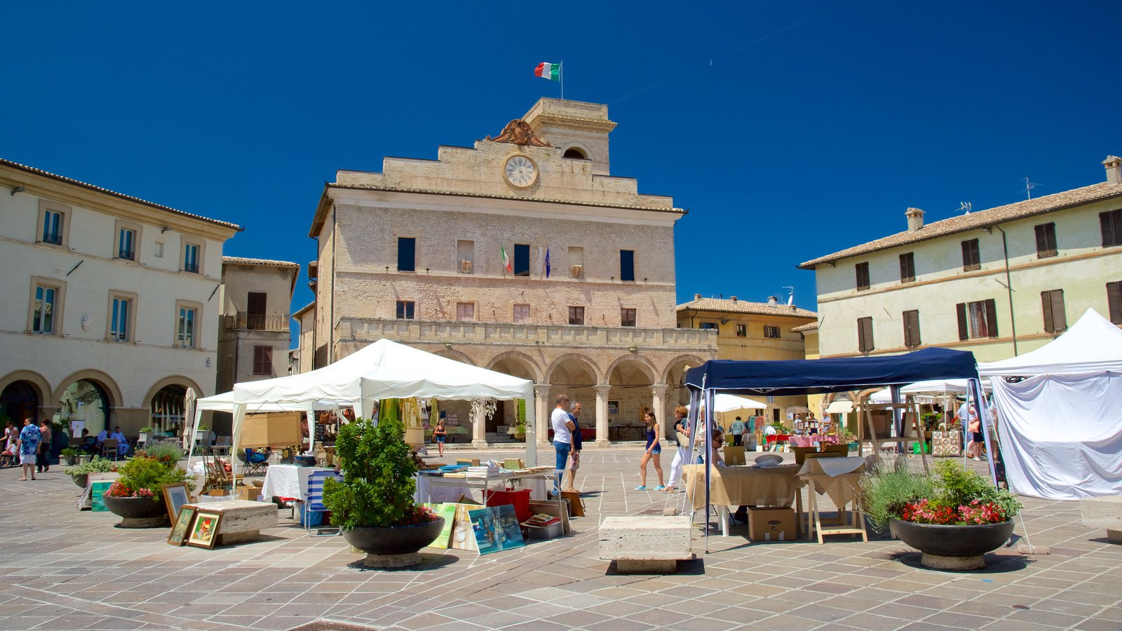 Montefalco which includes markets and a square or plaza