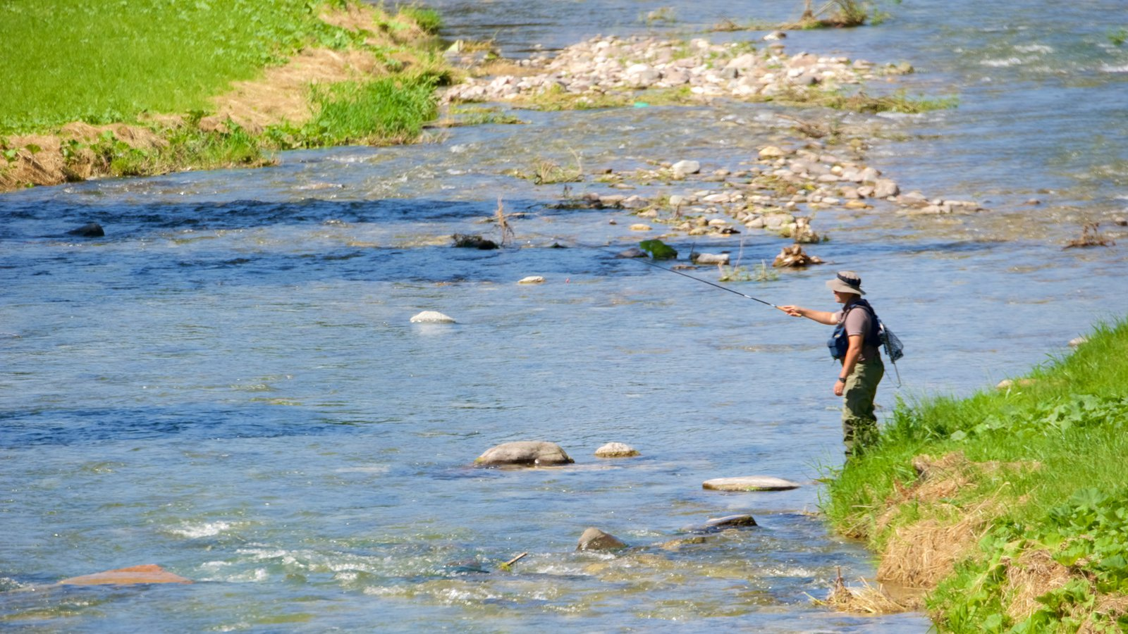 Moena featuring fishing and a river or creek as well as an individual male