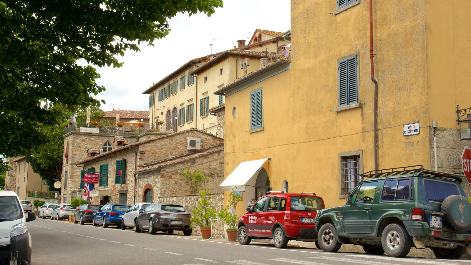 Radda in Chianti featuring street scenes, heritage architecture and a small town or village