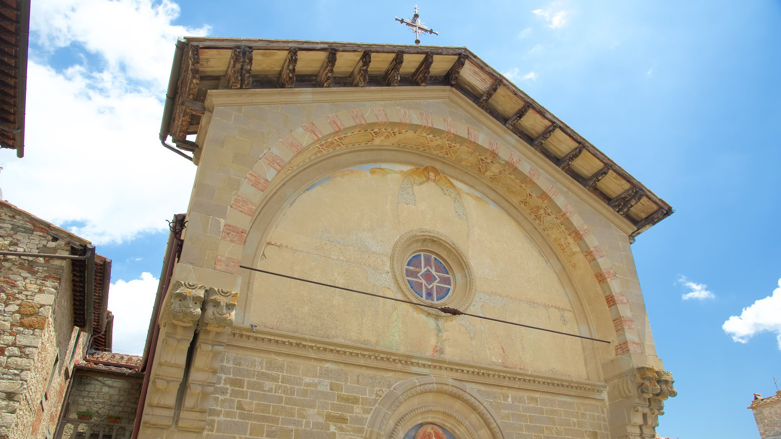 Radda in Chianti showing heritage architecture, a church or cathedral and a small town or village