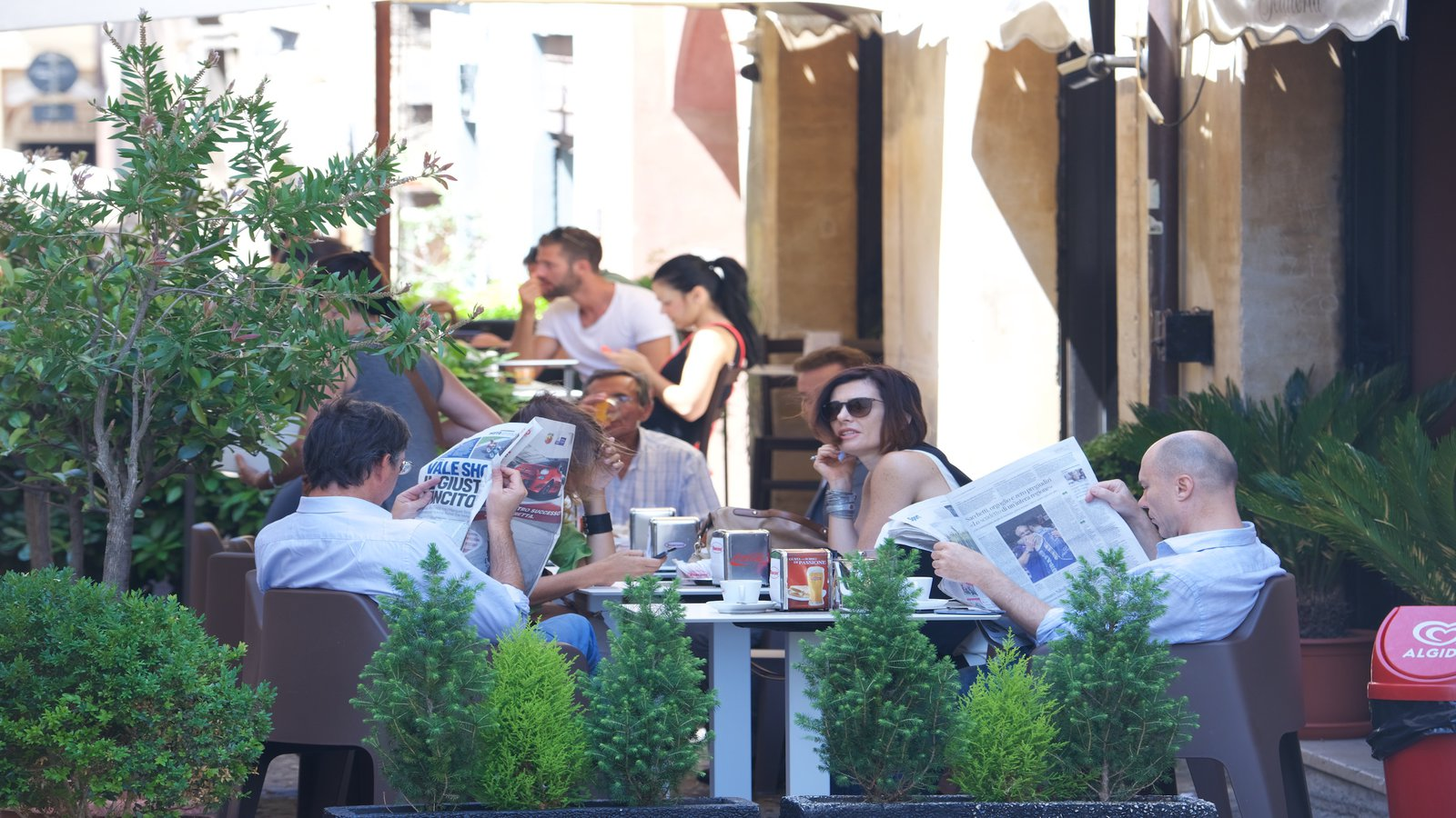 Montefalco which includes outdoor eating and cafe scenes as well as a small group of people