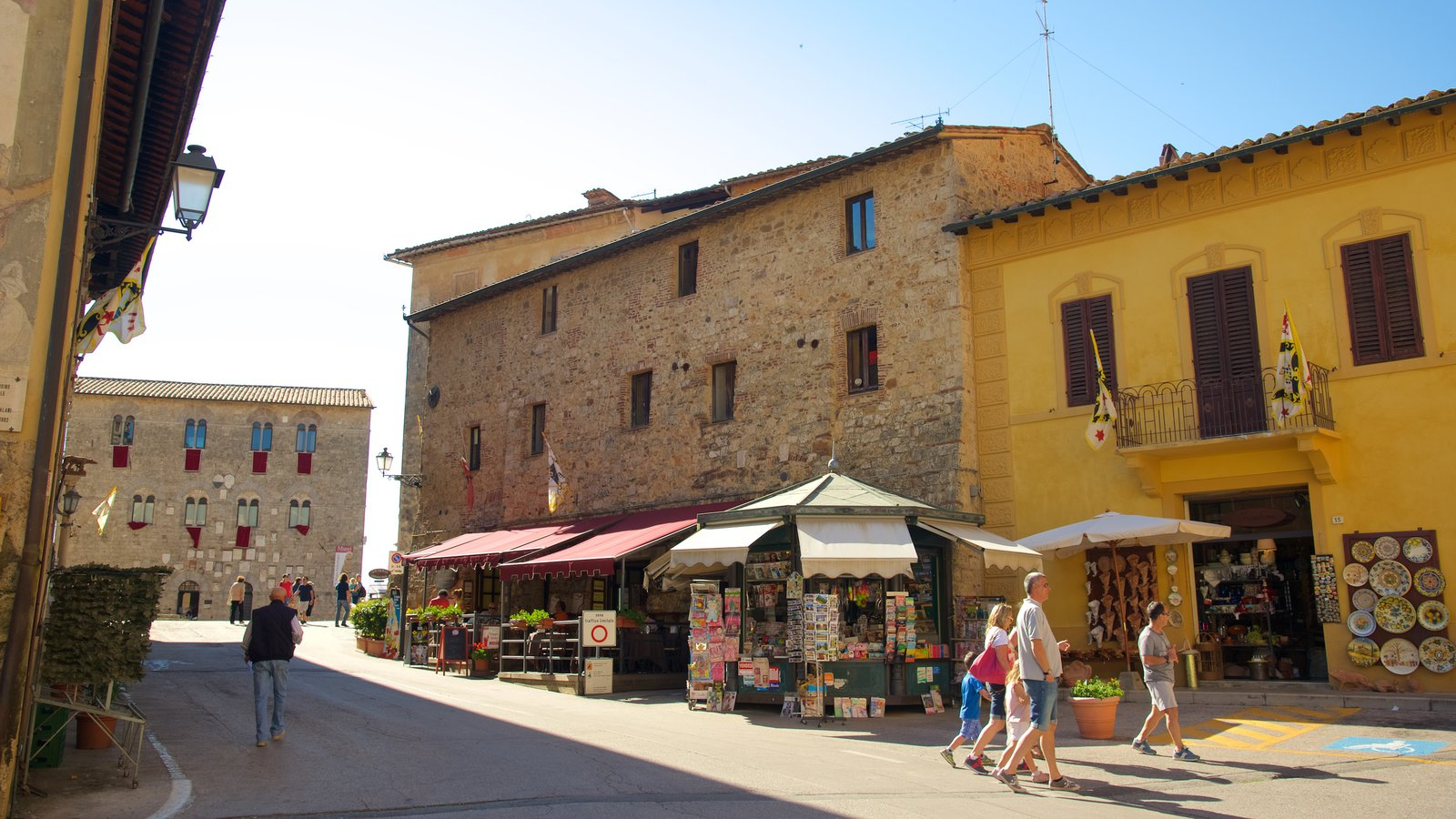 Massa Marittima which includes markets and street scenes as well as a small group of people