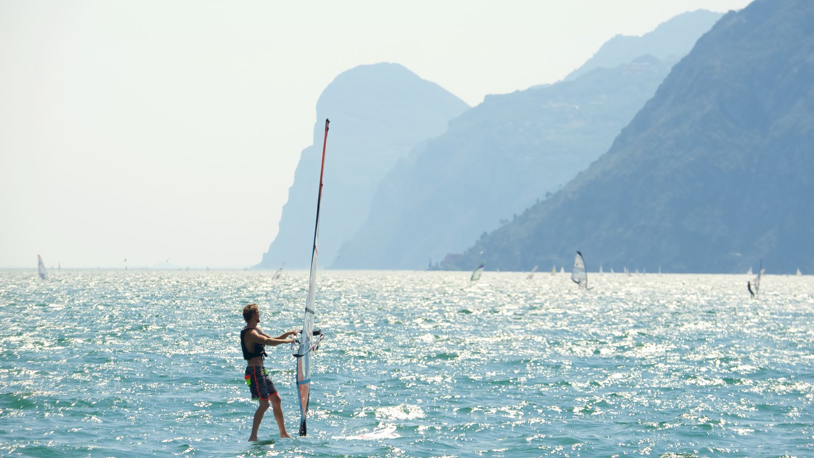 Nago-Torbole featuring general coastal views, mountains and windsurfing