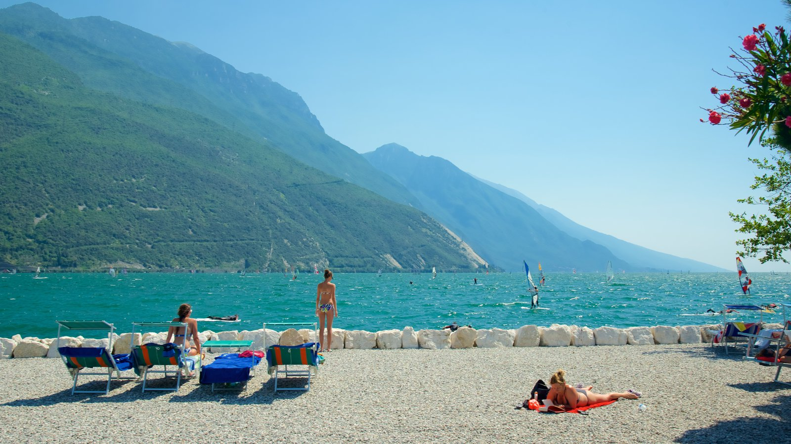 Nago-Torbole featuring general coastal views, mountains and a pebble beach