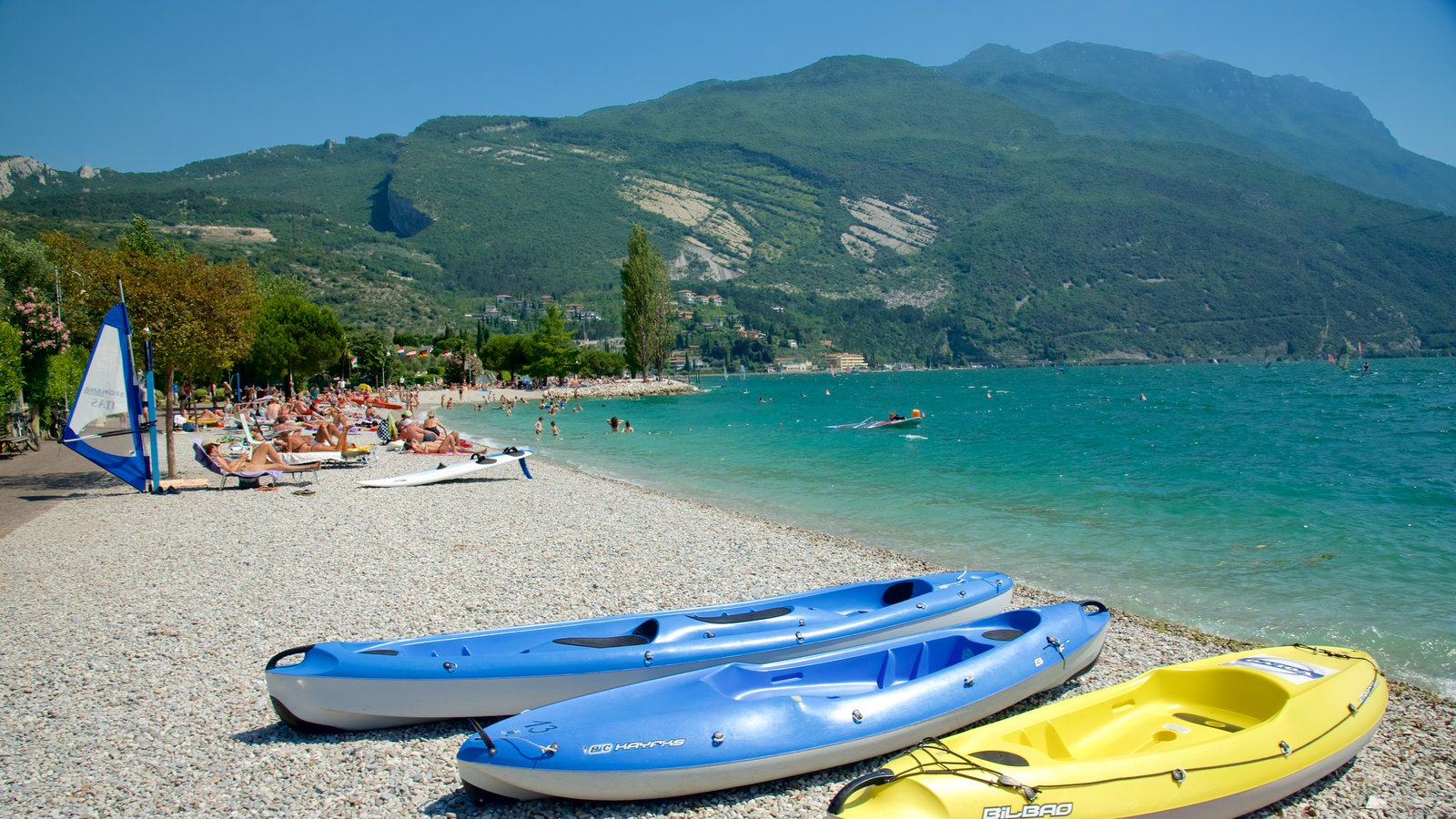 Nago-Torbole showing a pebble beach, general coastal views and kayaking or canoeing