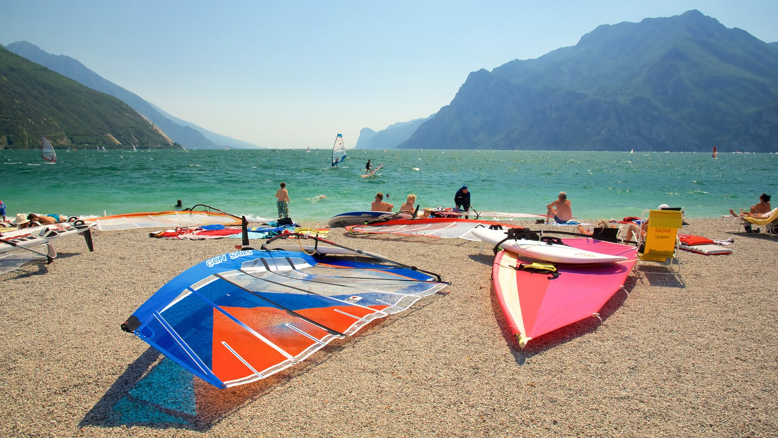 Nago-Torbole featuring mountains, windsurfing and a pebble beach