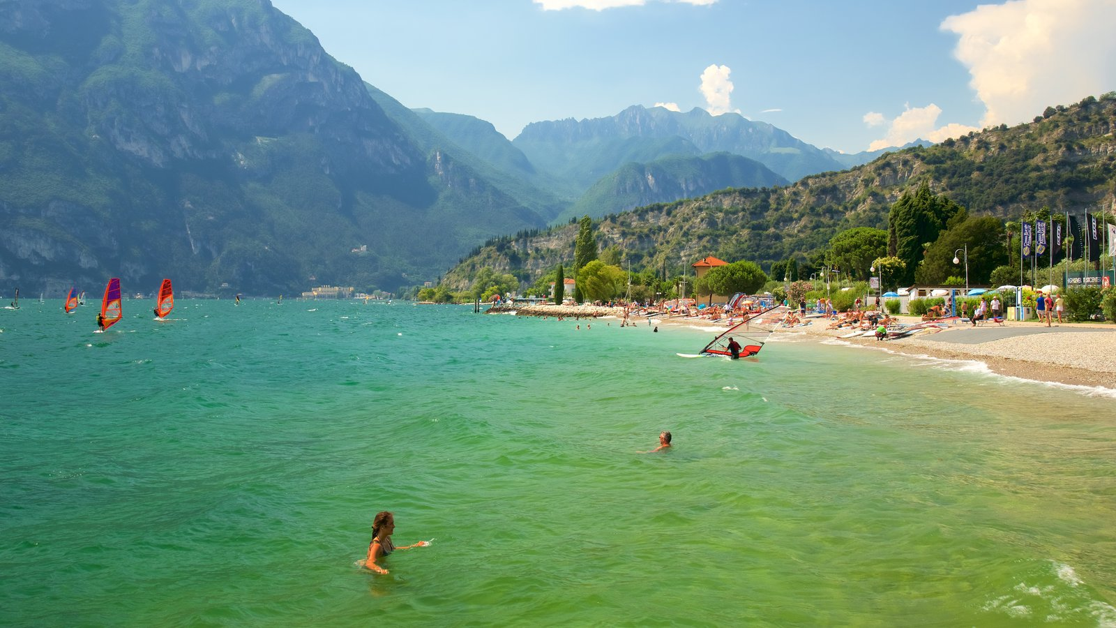 Nago-Torbole featuring swimming, general coastal views and windsurfing