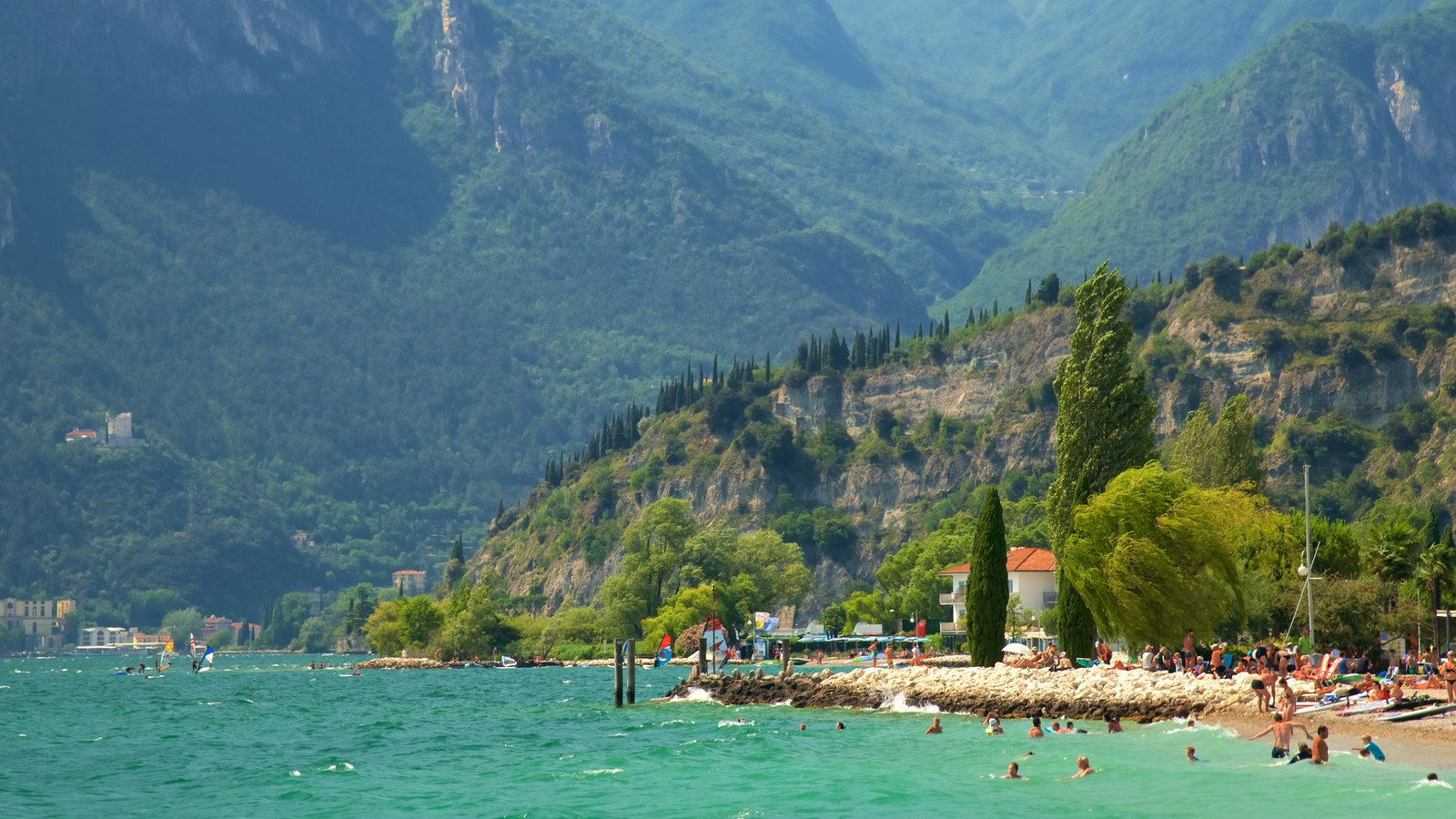 Nago-Torbole featuring a sandy beach, swimming and mountains