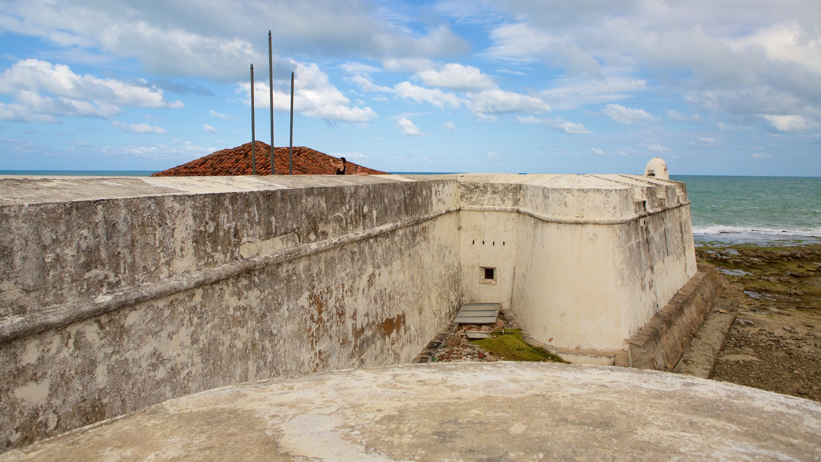 Fort of the Three Kings featuring general coastal views, building ruins and heritage elements