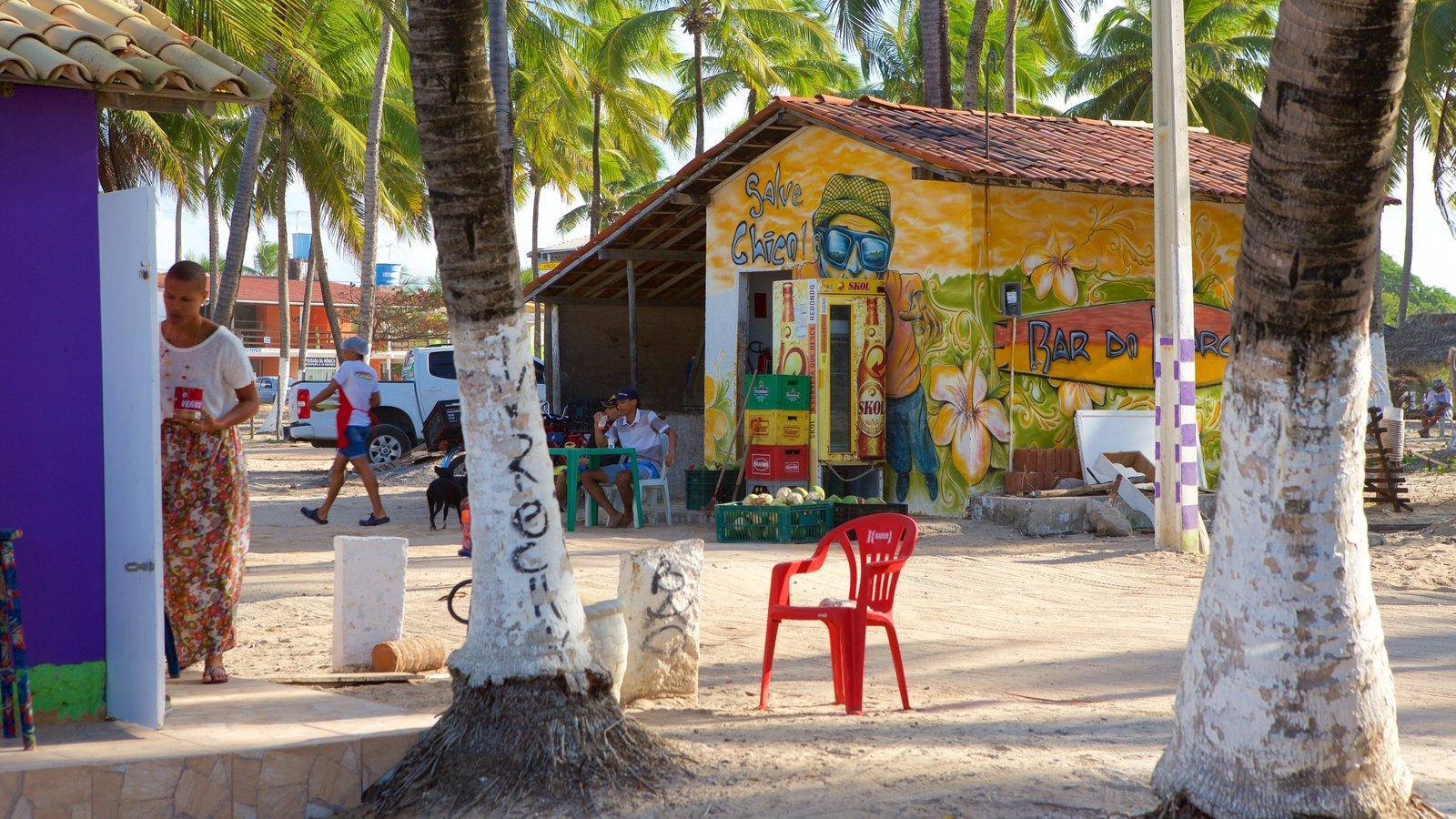 Praia de Maracaípe mostrando arte ao ar livre e uma cidade litorânea