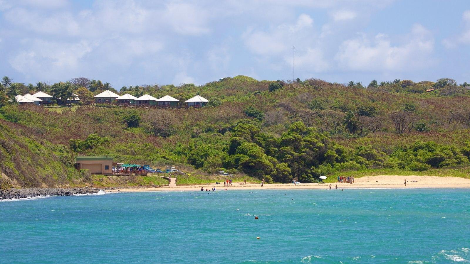 Praia do Sueste mostrando uma praia de areia, um hotel de luxo ou resort e paisagens litorâneas
