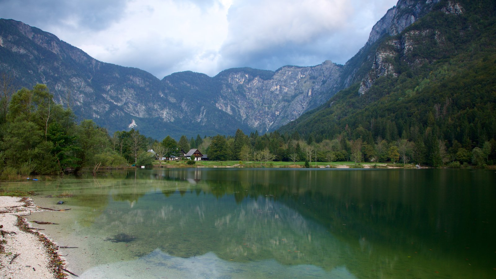 Lake Bohinj showing mountains and a lake or waterhole