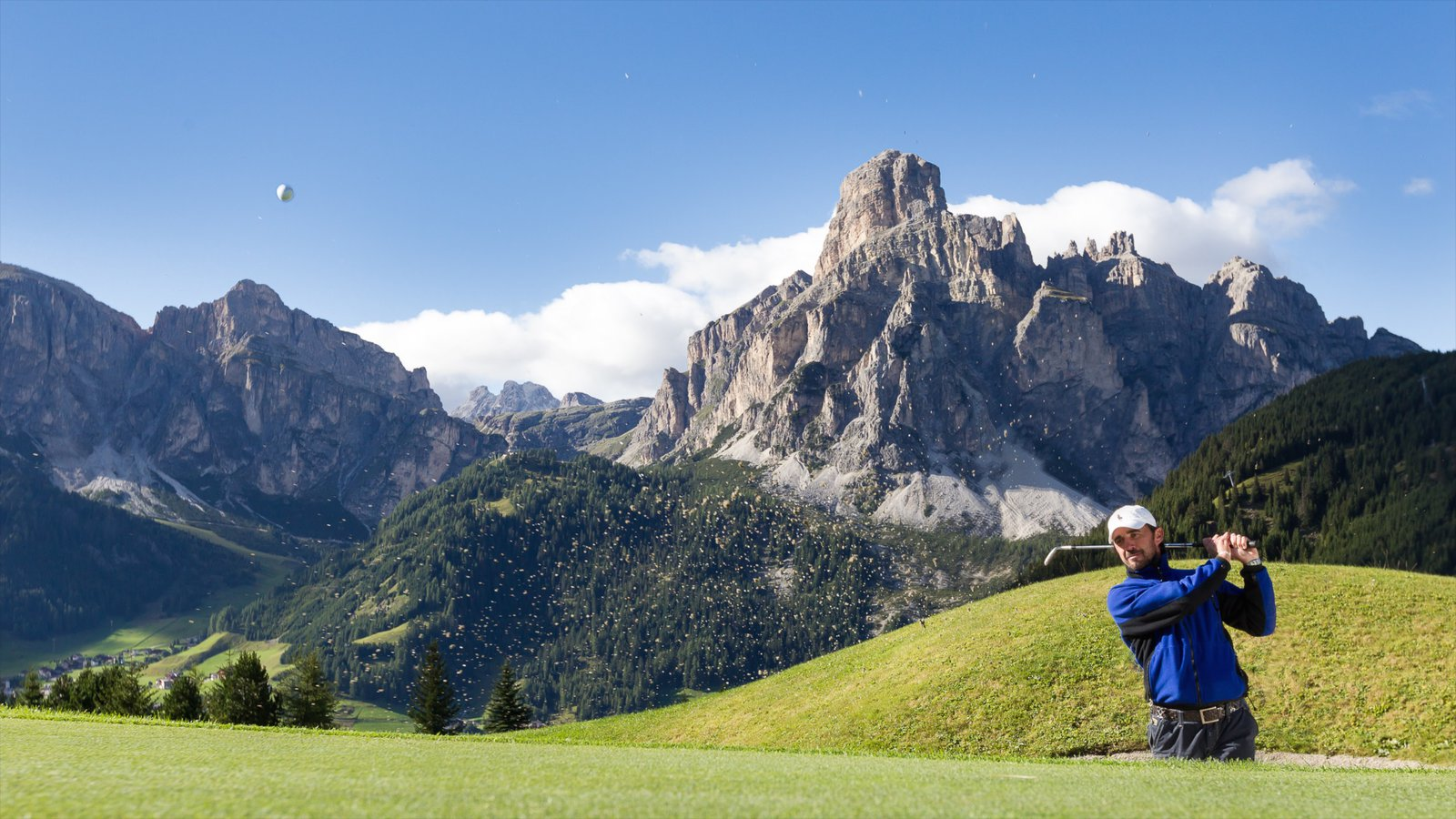 Corvara in Badia showing mountains and golf as well as an individual male