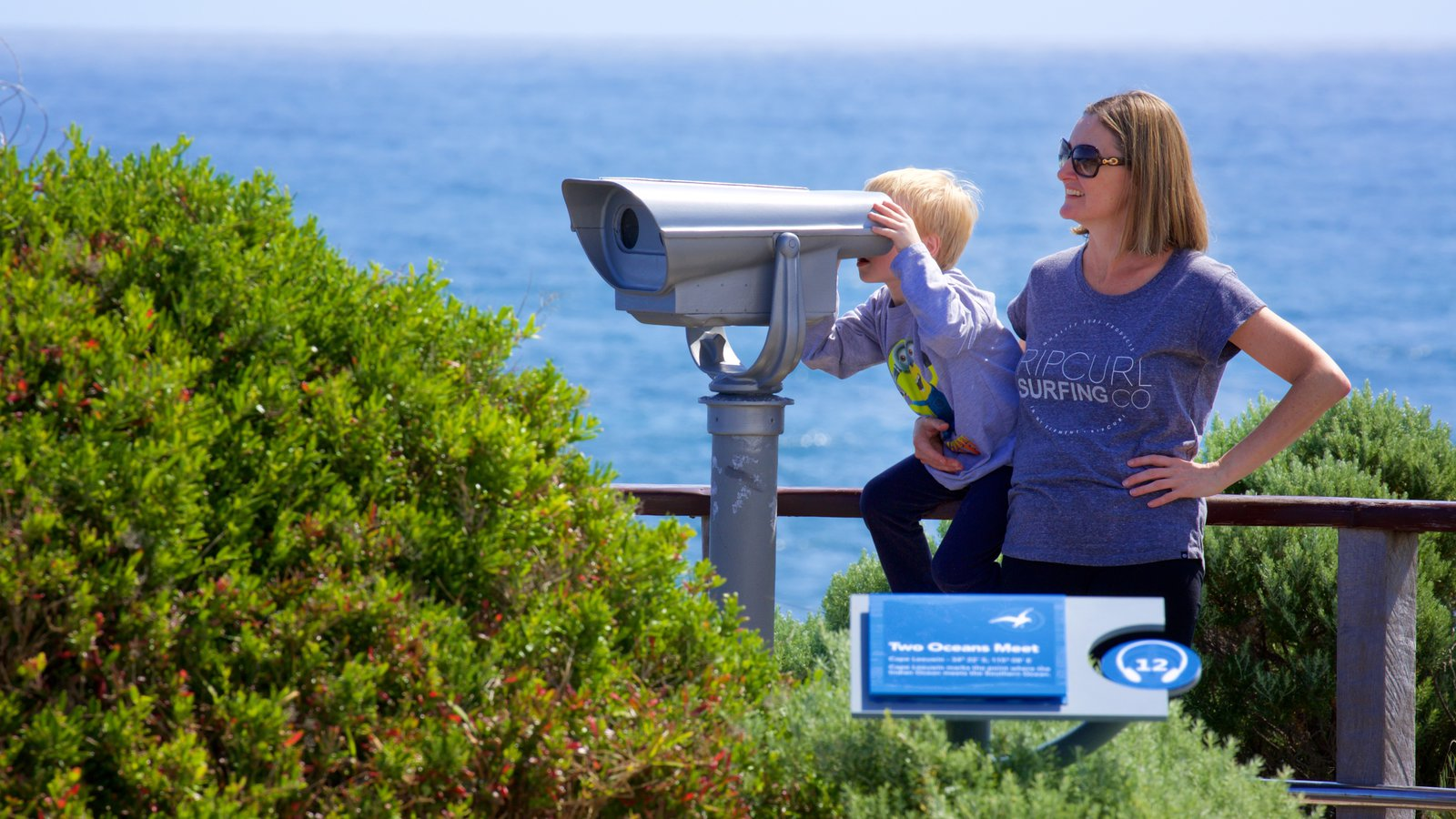 Cape Leeuwin Lighthouse showing signage and general coastal views as well as a family
