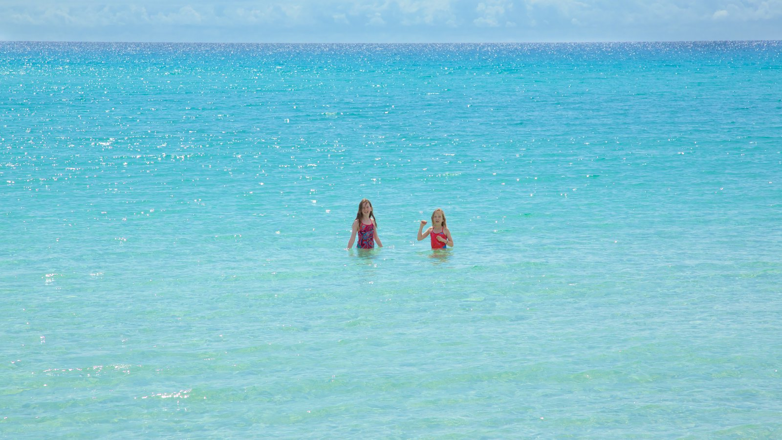 Naturaliste featuring general coastal views and swimming as well as children