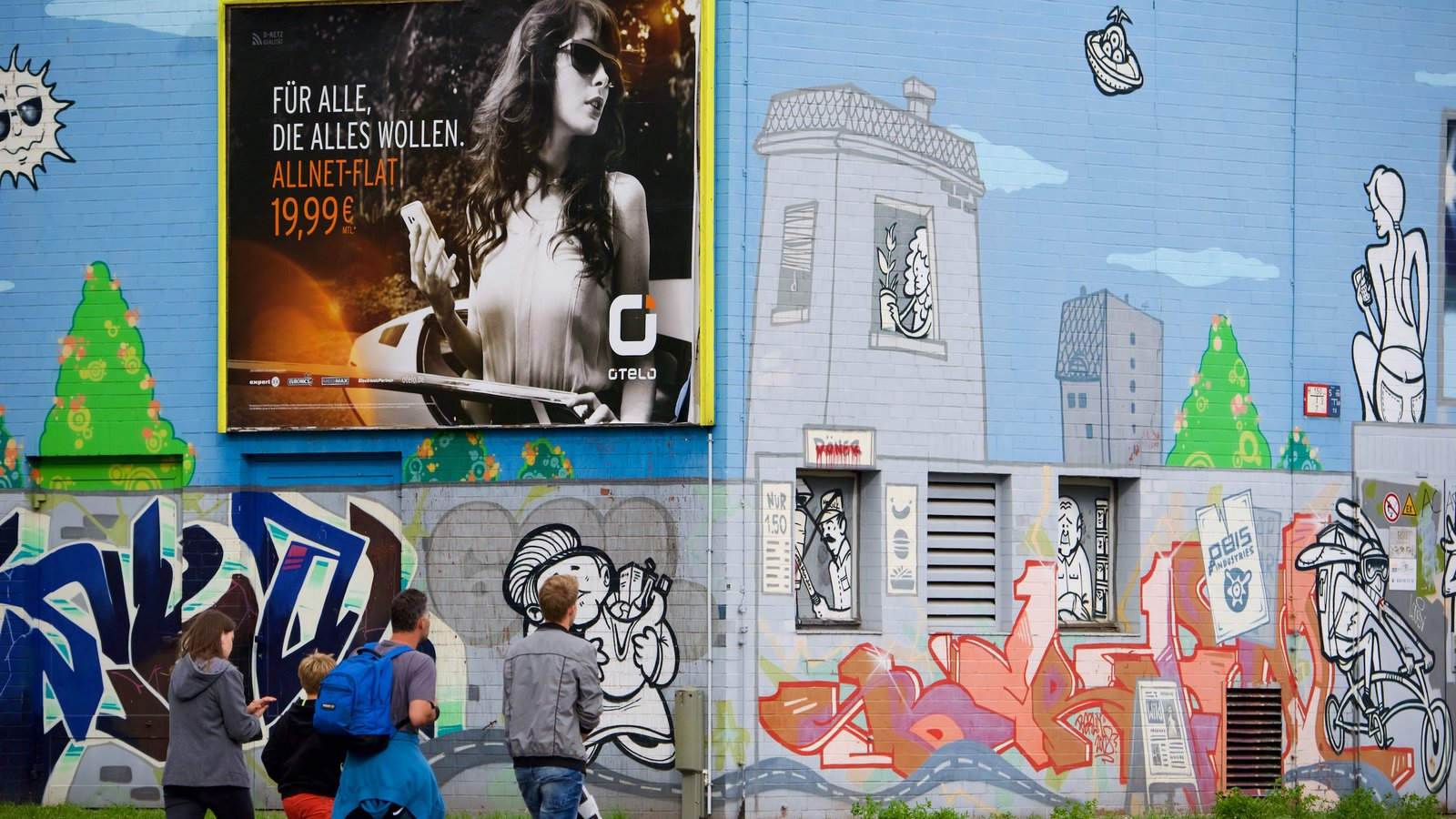 Friedrichshain featuring outdoor art as well as a family