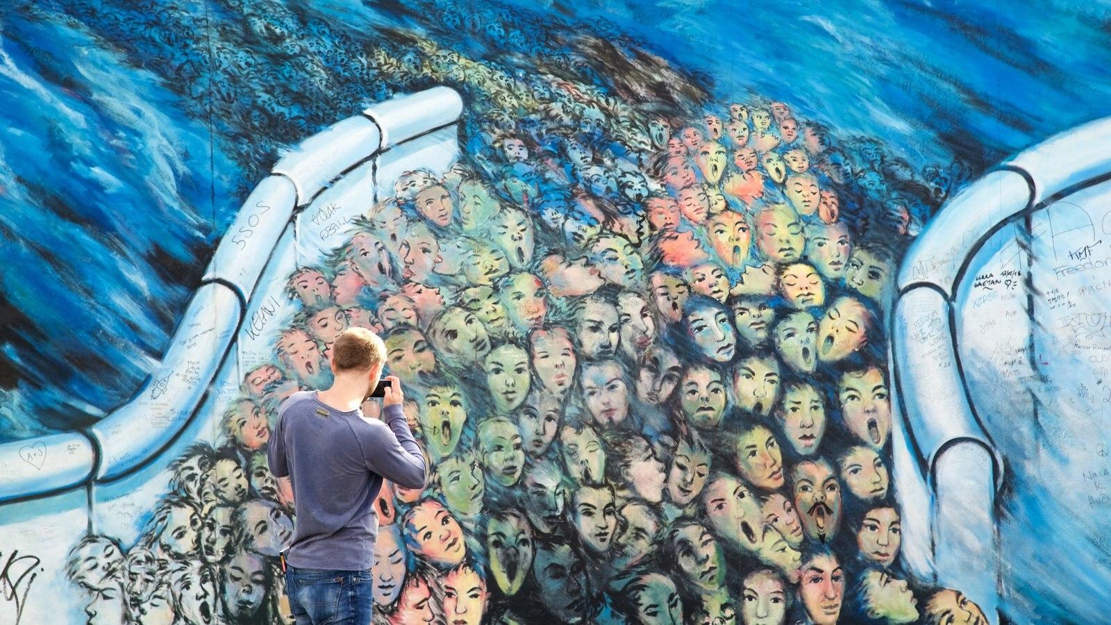 Friedrichshain showing outdoor art as well as an individual male