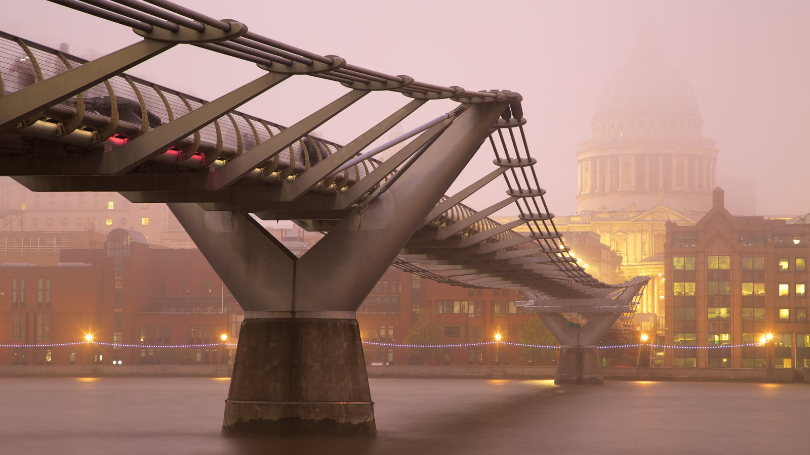 London Millennium Footbridge showing a river or creek, mist or fog and a city