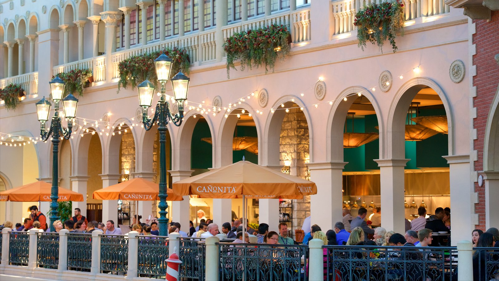 Grand Canal Shoppes featuring dining out and a casino as well as a large group of people