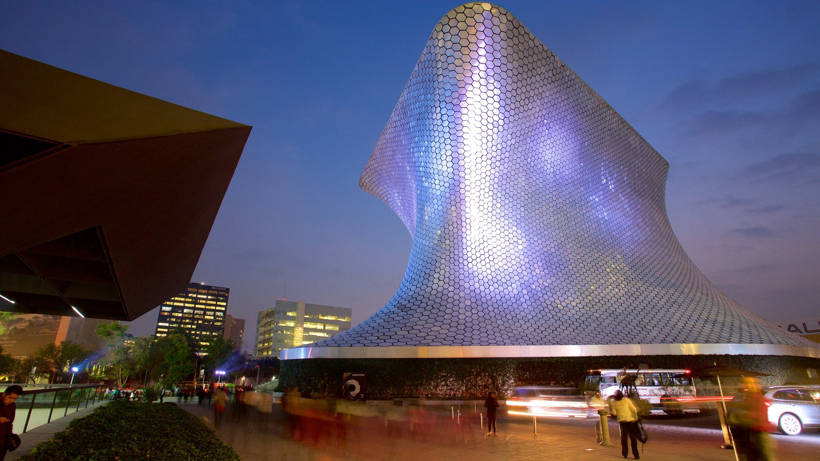 Museo Soumaya which includes modern architecture, night scenes and a square or plaza