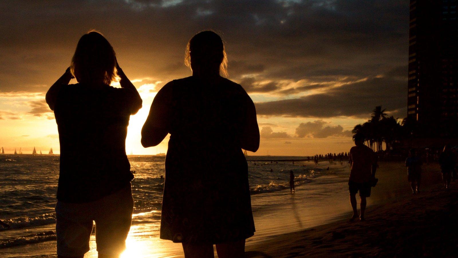 Waikiki Beach featuring general coastal views, a sandy beach and a sunset